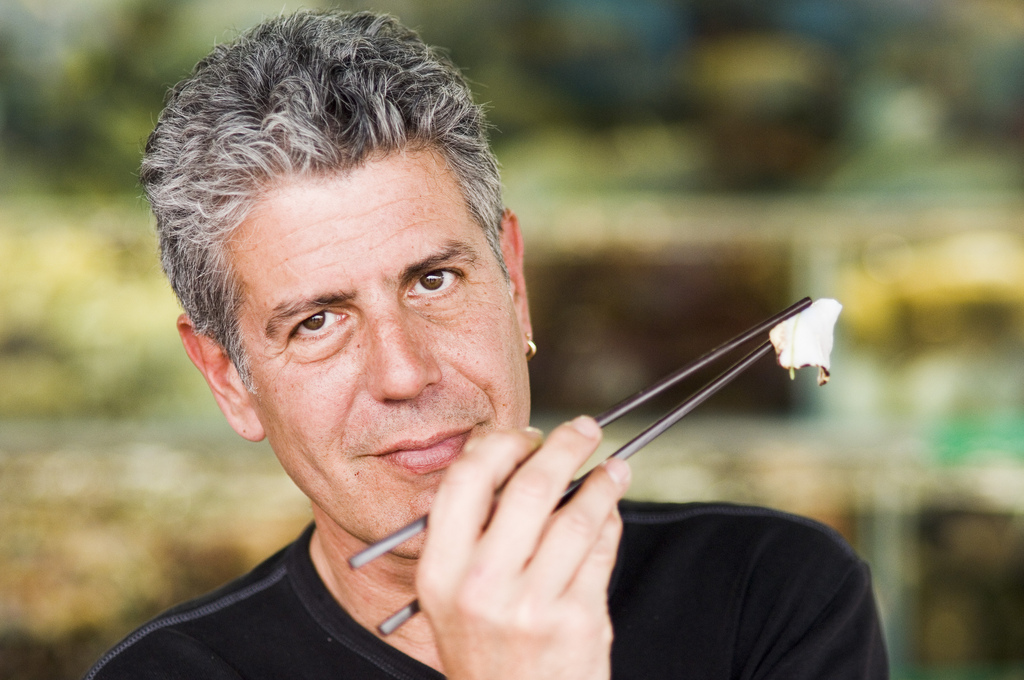 anthony bourdain with chop sticks