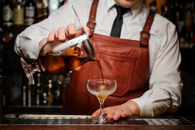 bartender-serving-drink-in-fancy-glass