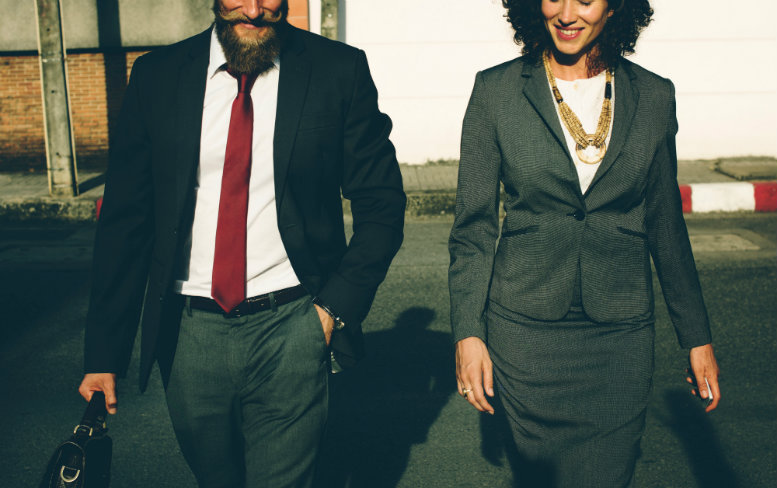 Man and woman in suits walking