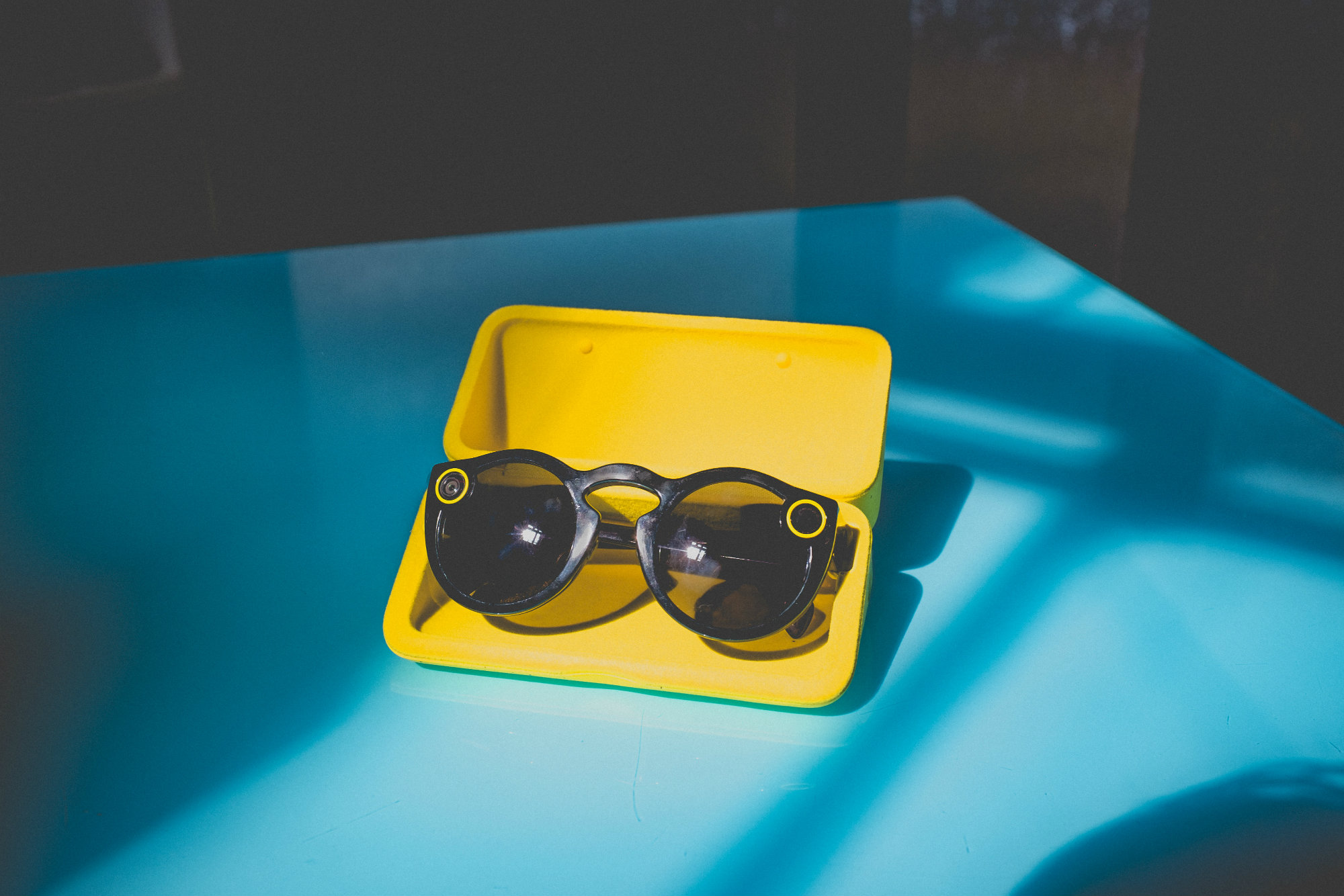 yellow tray displaying sunglasses