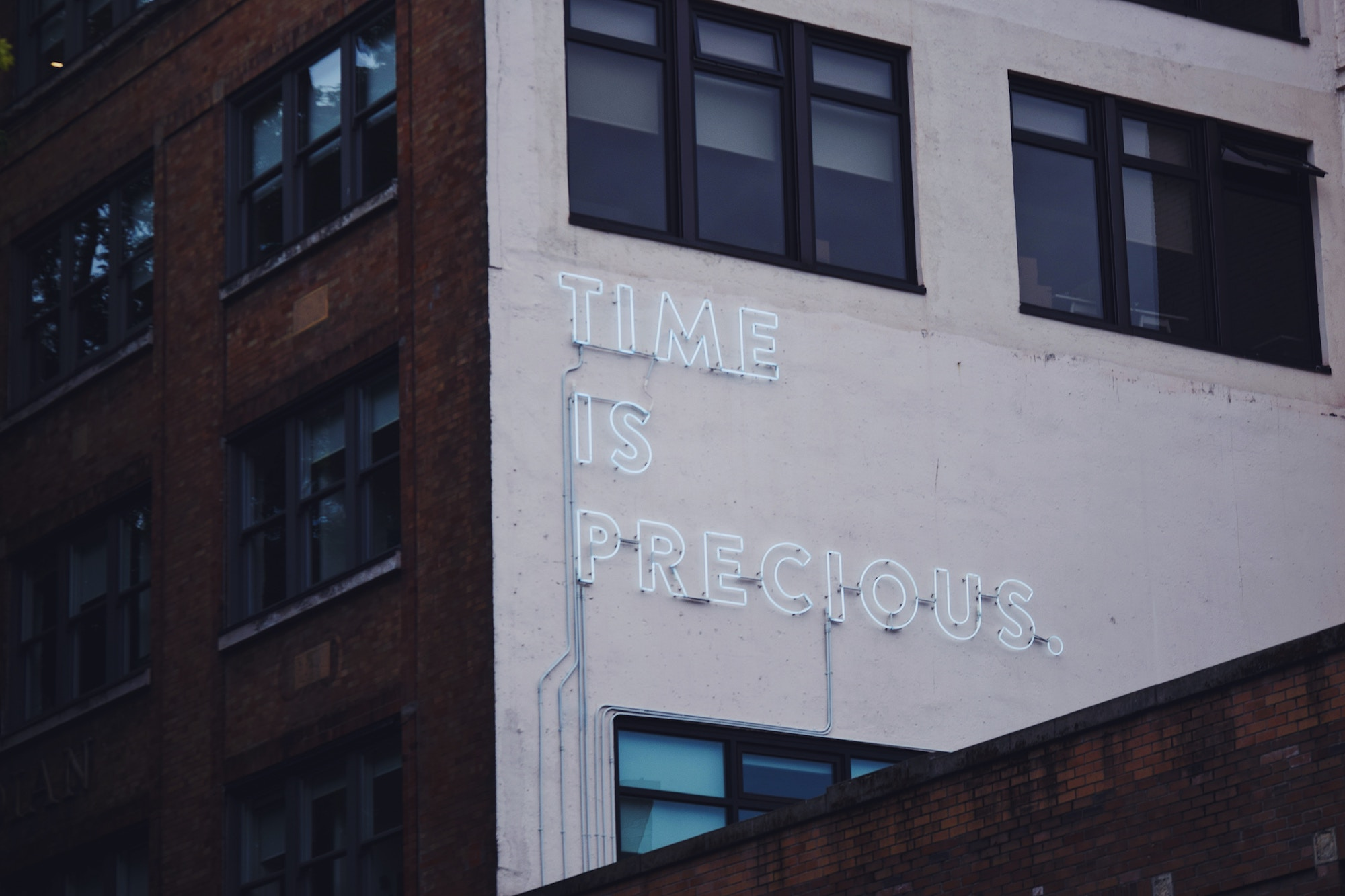 time is precious sign on building