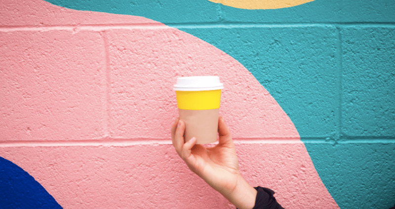 coffee cup and colorful wall