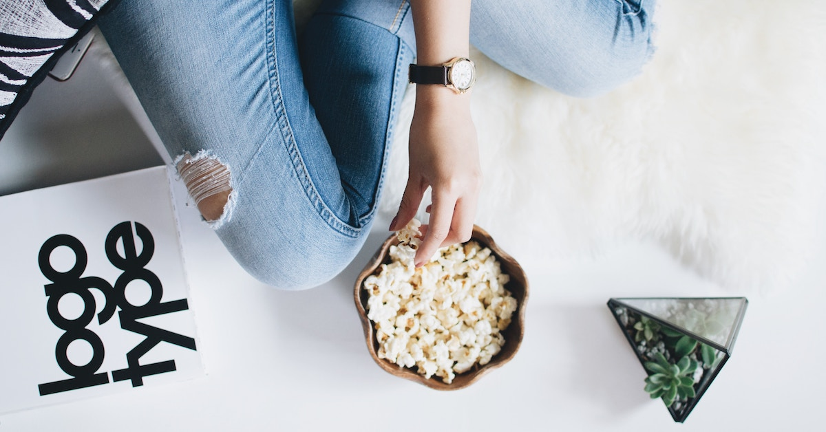 women sitting eating popcorn